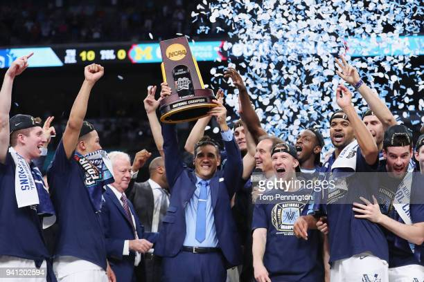 Head coach Jay Wright of the Villanova Wildcats raises the trophy with his team after defeating the Michigan Wolverines during the 2018 NCAA Men's...