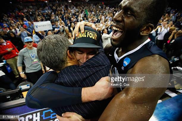 Head coach Jay Wright of the Villanova Wildcats, Ryan Arcidiacono, and Daniel Ochefu celebrate defeating the Kansas Jayhawks 64-59 during the 2016...