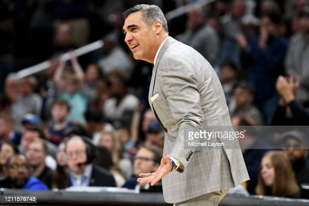 Head coach Jay Wright of the Villanova Wildcats signals to his players during a college basketball game against the Georgetown Hoyas at the Capital...