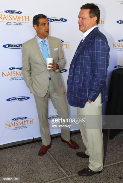 Head coach Jay Wright of the Villanova Wildcats speaks with head coach Bill Self of the Kansas Jayhawks during the 2017 Naismith Awards Brunch at the...