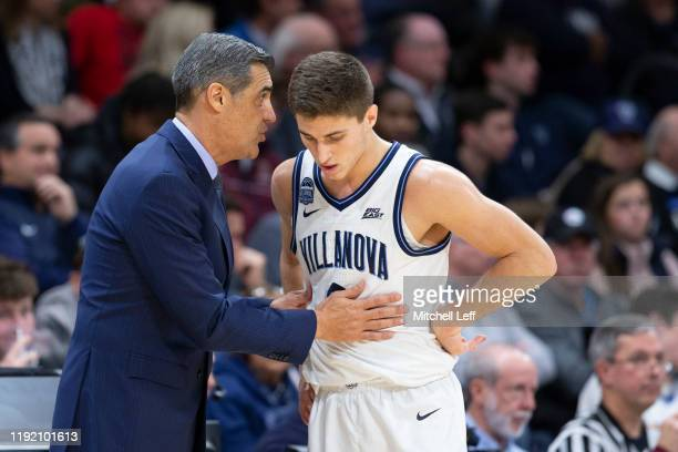 Head coach Jay Wright of the Villanova Wildcats talks to Collin Gillespie against the La Salle Explorers at Finneran Pavilion on December 1, 2019 in...