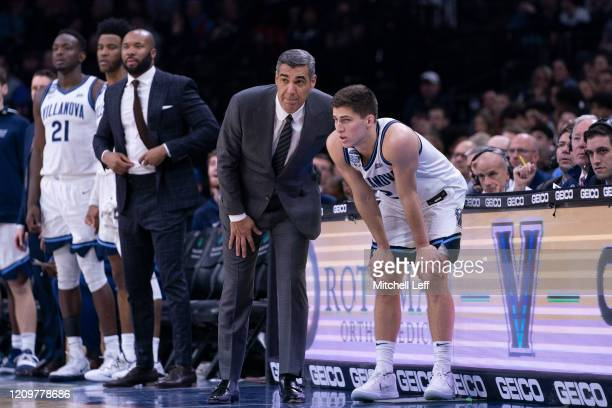 Head coach Jay Wright of the Villanova Wildcats talks to Collin Gillespie against the Providence Friars at the Wells Fargo Center on February 29,...