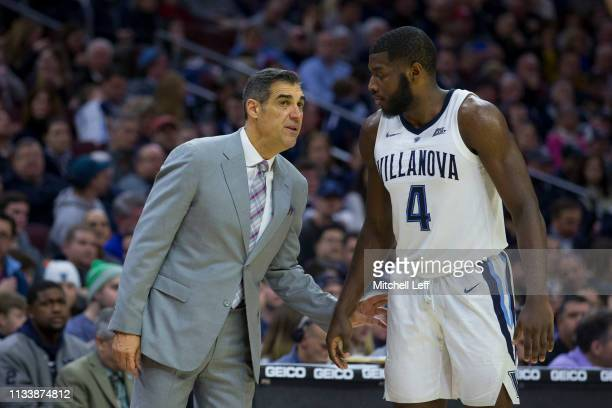 Head coach Jay Wright of the Villanova Wildcats talks to Eric Paschall against the Butler Bulldogs at the Wells Fargo Center on March 2, 2019 in...