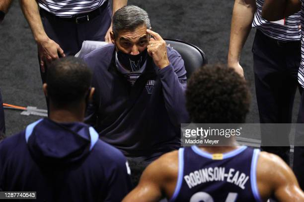 Head coach Jay Wright of the Villanova Wildcats talks with Jeremiah Robinson-Earl during a time out in the first half against the Boston College...