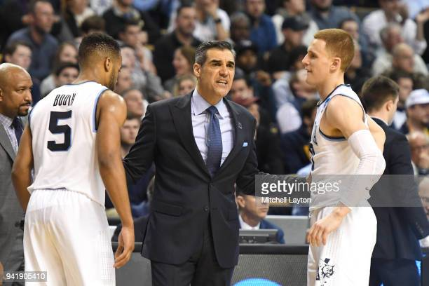 Head coach Jay Wright of the Villanova Wildcats talks with Phil Booth and Donte DiVincenzo during the 2018 NCAA Men's Basketball Tournament East...