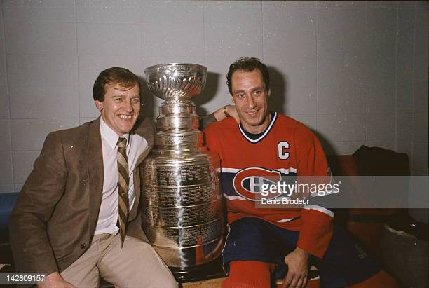 Head Coach Jean Perron of the Montreal Canadiens and Bob Gainey of the Montreal Canadiens pose for a photo with the Stanley Cup at the Montreal Forum...