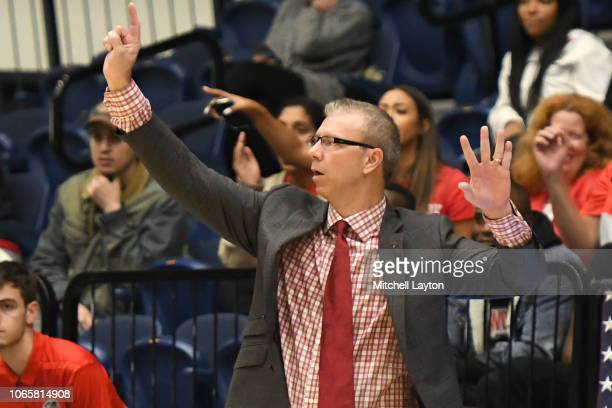 Head coach Jeff Boals of the Stony Brook Seawolves signal to his players during a college basketball game against the George Washington Colonials at...