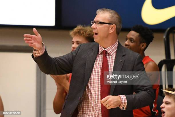 Head coach Jeff Boals of the Stony Brook Seawolves signals his players during a college basketball game against the George Washington Colonials at...