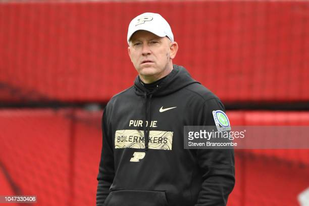 Head coach Jeff Brohm of the Purdue Boilermakers watches warm ups before the game against the Nebraska Cornhuskers at Memorial Stadium on September...