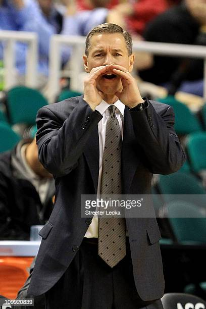 Head coach Jeff Bzdelik of the Wake Forest Demon Deacons communicates with the team while playing against the Boston College Eagles during the first...