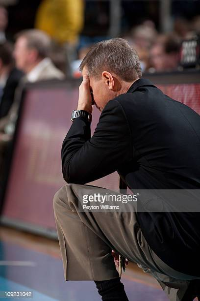 Head coach Jeff Bzdelik of the Wake Forest Demon Deacons holds his head down in dejection in a closing moments of a loss to the North Carolina Tar...