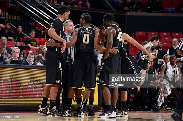 Head coach Jeff Bzdelik of the Wake Forest Demon Deacons talks to his team during a timeout in the game against the Maryland Terrapins at the Comcast...