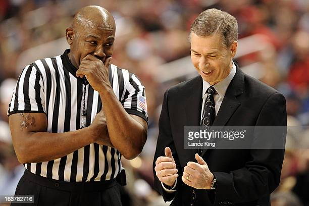 Head Coach Jeff Bzdelik of the Wake Forest Demon Deacons talks with referee Les Jones during a game against the Maryland Terrapins during the first...