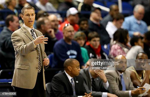 Head coach Jeff Bzdelik of the Wake Forest Demon Deacons yells to his team against the Pittsburgh Panthers during the second round of the 2014 Men's...