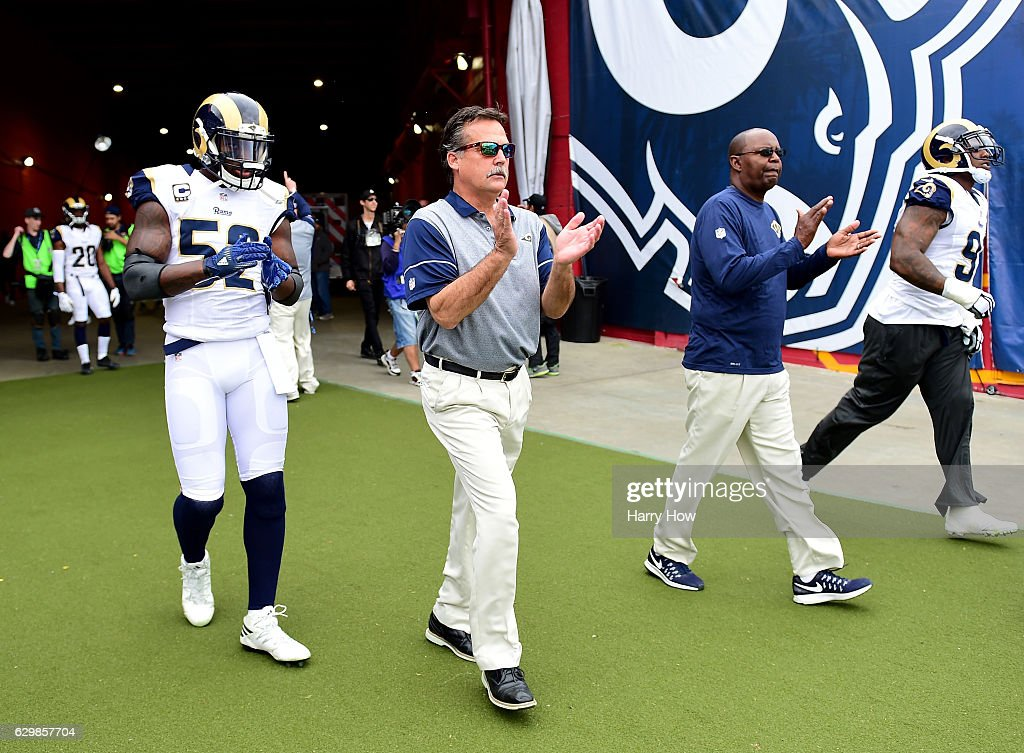 Head coach Jeff Fisher of the Los Angeles Rams comes on to the field with Alec Ogletree #52 before the game against the Atlanta Falcons at Los Angeles Memorial Coliseum on December 11, 2016 in Los Angeles, California.
