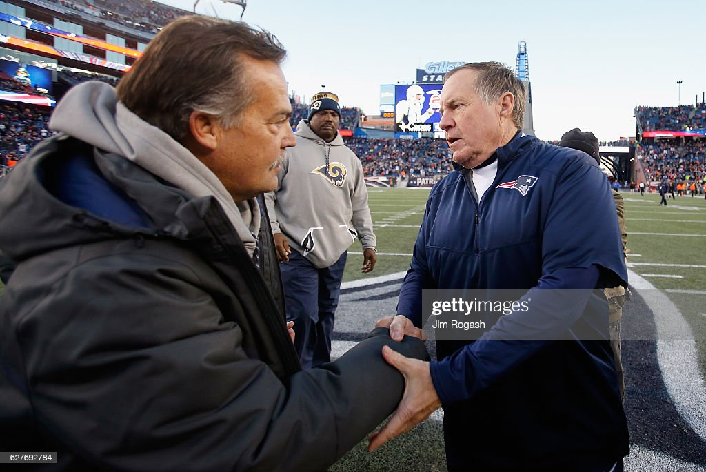 Head coach Jeff Fisher of the Los Angeles Rams (L) shakes hands with head coach Bill Belichick of the New England Patriots after the Patriots defeated the Rams 26-10 at Gillette Stadium on December 4, 2016 in Foxboro, Massachusetts.