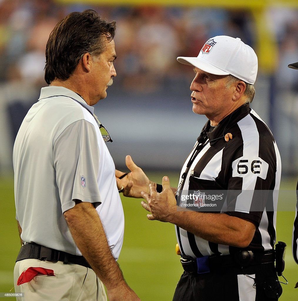 Head coach Jeff Fisher of the St. Louis Rams speaks to referee Walt Anderson #66 during a pre-season game against the Tennessee Titans at LP Field on August 23, 2015 in Nashville, Tennessee.