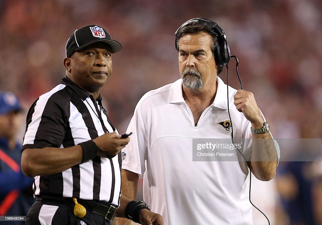 Head coach Jeff Fisher of the St. Louis Rams talks with line judge Darryll Lewis #130 during the NFL game against the Arizona Cardinals at the University of Phoenix Stadium on November 25, 2012 in Glendale, Arizona. The Rams defeated the Cardinals 31-17.