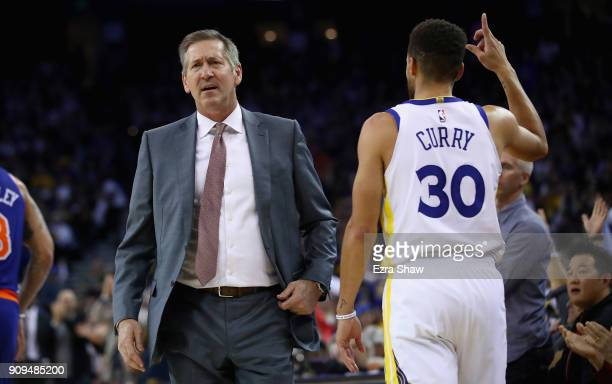 Head coach Jeff Hornacek of the New York Knicks complains about a call as Stephen Curry of the Golden State Warriors reacts after making a threepoint...