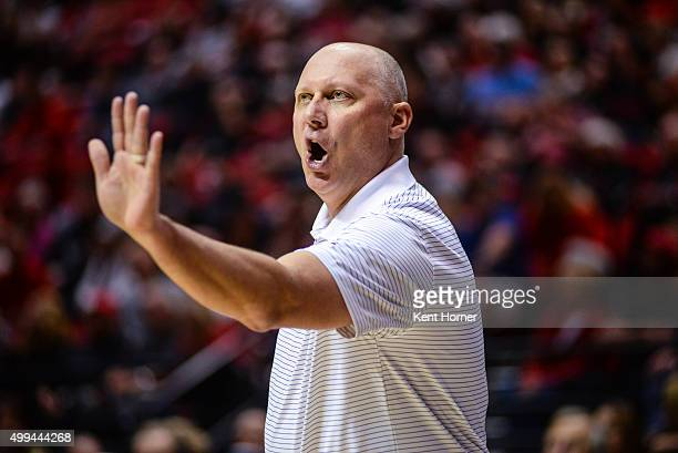 Head coach Jeff Lebo of the East Carolina Pirates directs his players from the bench area in the first half against the San Diego State Aztecs at...