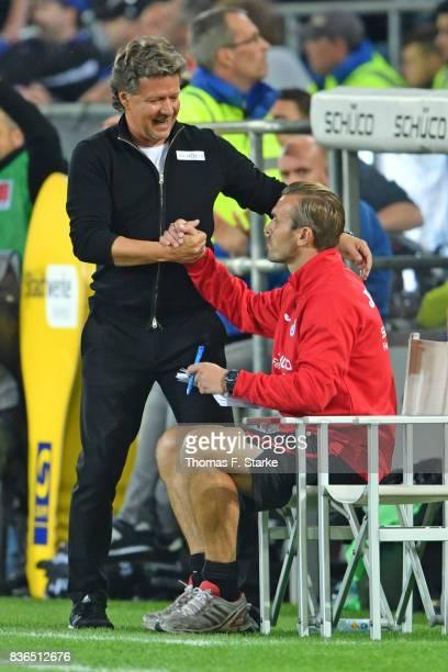 Head coach Jeff Saibene and assistant coach Carsten Rump celebrate during the Second Bundesliga match between DSC Arminia Bielefeld and VfL Bochum...
