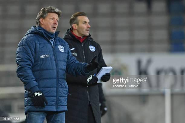 Head coach Jeff Saibene and assistant coach Carsten Rump react during the Second Bundesliga match between DSC Arminia Bielefeld and 1 FC Union Berlin...
