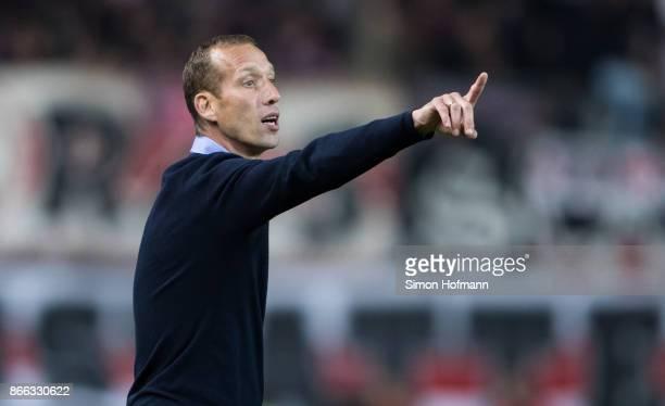 Head coach Jeff Strasser of Kaiserslautern gestures during the DFB Cup match between 1 FC Kaiserslautern and VfB Stuttgart at FritzWalterStadion on...