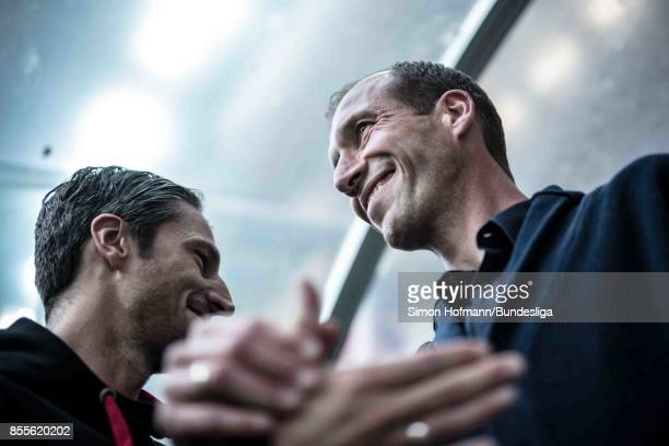 Head coach Jeff Strasser of Kaiserslautern shakes hands in the tunnel during the Second Bundesliga match between 1 FC Kaiserslautern and SpVgg...