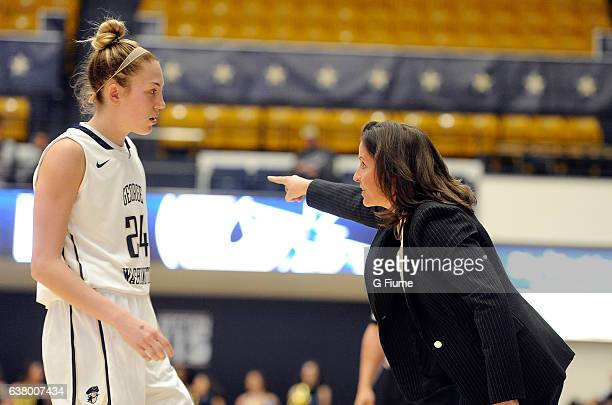 Head Coach Jennifer Rizzotti of the George Washington Colonials talks with Lexi Martins during the game against the Virginia Commonwealth Lady Rams...