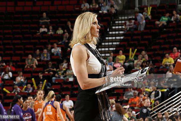 Head coach Jenny Boucek of the Seattle Storm draws up plays during the WNBA game against the Phoenix Mercury on June 3 2016 at Key Arena in Seattle...
