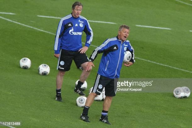 Head coach Jens Keller and assistant coach Peter Herrmann attend a FC Schalke 04 training session on June 27 2013 in Gelsenkirchen Germany