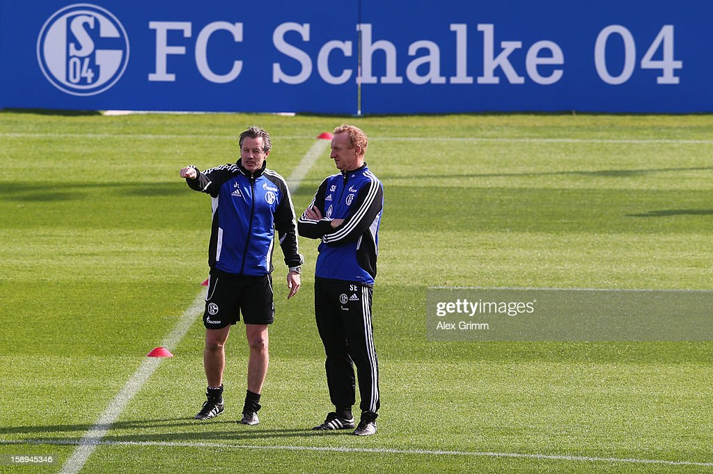 Head coach Jens Keller (L) and assistant coach Seppo Eichkorn prepare a Schalke 04 training session at the ASPIRE Academy for Sports Excellenc on January 4, 2013 in Doha, Qatar.