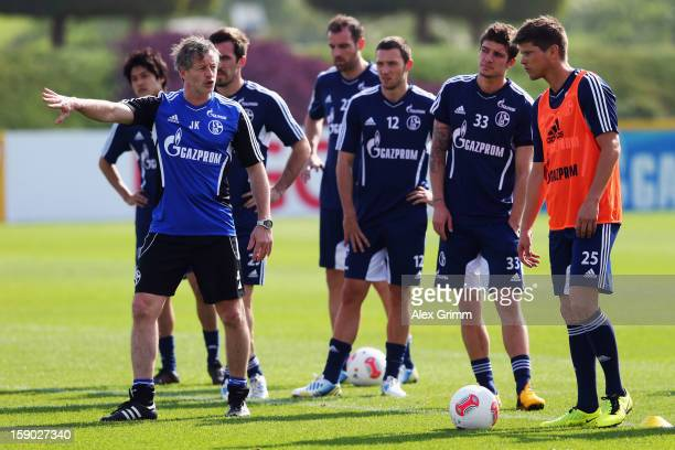 Head coach Jens Keller gives instructions during a Schalke 04 training session at the ASPIRE Academy for Sports Excellence on January 6 2013 in Doha...