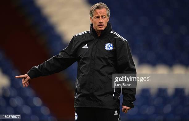 Head coach Jens Keller is seen during a FC Schalke 04 training session ahead of their UEFA Champions League Group E match against FC Steaua Bucuresti...
