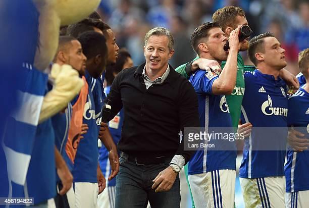 Head coach Jens Keller of Schalke celebrates with his players after winning the Bundesliga match between FC Schalke 04 and Borussia Dortmund at...