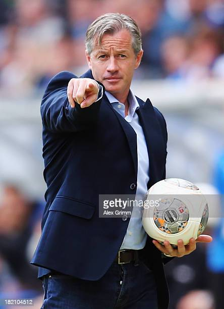 Head coach Jens Keller of Schalke rasct during the Bundesliga match between 1899 Hoffenheim and FC Schalke 04 on September 28 2013 in Sinsheim Germany