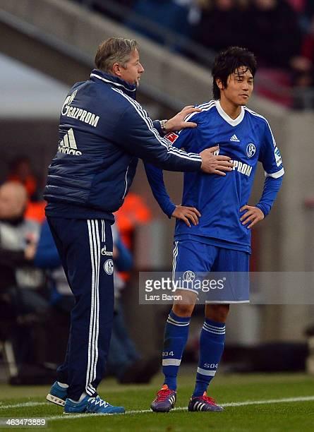 Head coach Jens Keller of Schalke speaks with Atsuto Uchida during a test match between 1 FC Koeln and FC Schalke 04 at RheinEnergieStadion on...