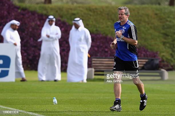 Head coach Jens Keller runs during a Schalke 04 training session at the ASPIRE Academy for Sports Excellence on January 7 2013 in Doha Qatar