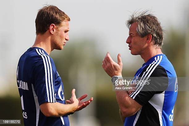 Head coach Jens Keller talks to Benedikt Hoewedes during a Schalke 04 training session at the ASPIRE Academy for Sports Excellenceag on January 9...