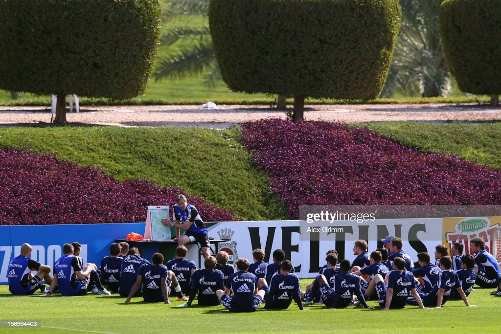 Head coach Jens Keller talks to the players during a Schalke 04 training session at the ASPIRE Academy for Sports Excellence on January 5, 2013 in Doha, Qatar.