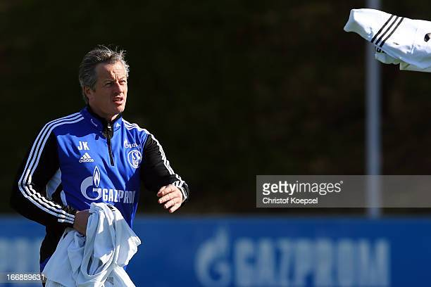 Head coach Jens Keller throws a training jersey during the FC Schalke 04 training session at their training ground on April 18 2013 in Gelsenkirchen...