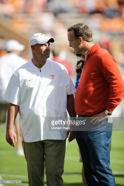 Head Coach Jeremy Pruitt of the Tennessee Volunteers and Peyton Manning talk before the game between the Alabama Crimson Tide and the Tennessee...