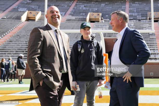 Head coach Jeremy Pruitt of the Tennessee Volunteers laughs with head coach Brad Lambert of the Charlotte 49ers before the game between the Charlotte...