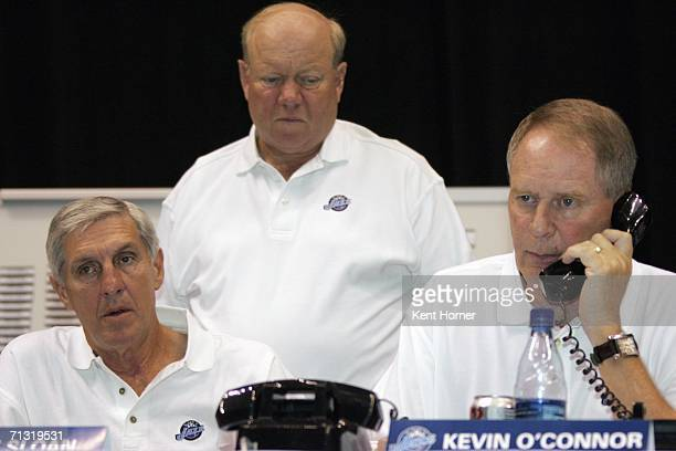 Head coach Jerry Sloan and owner Larry Miller of the Utah Jazz look on as general manager Kevin O'Connor speaks on the phone during the 2006 NBA...