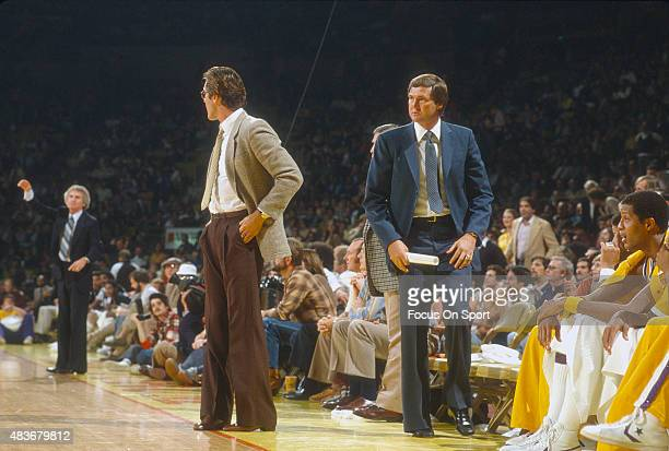 Head coach Jerry West and assistant coach Pat Riley of the Los Angeles Lakers looks on during an NBA basketball game circa 1979 at The Forum in...