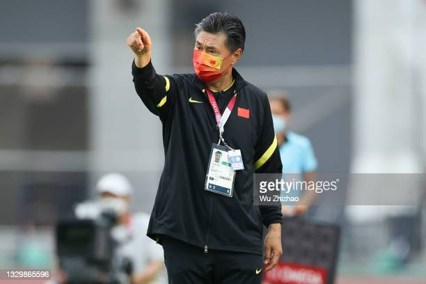 Head coach Jia Xiuquan of China reacts in the Women's First Round Group F match between China and Brazil during the Tokyo 2020 Olympic Games at...