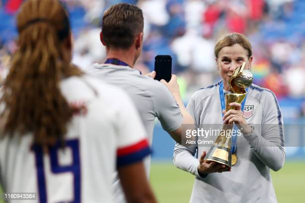 Head coach Jill Ellis of the USA celebrates with the FIFA Women's World Cup Trophy following the 2019 FIFA Women's World Cup France Final match...