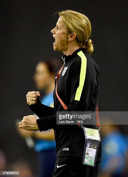 Head coach Jill Ellis of USA celebrates after winning the FIFA Women's World Cup 2015 Semi Final match between USA and Germany at Olympic Stadium on...