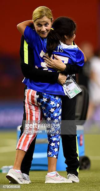 Head coach Jill Ellis of USA celebrates with her daughter after winning the FIFA Women's World Cup 2015 Semi Final match between USA and Germany at...