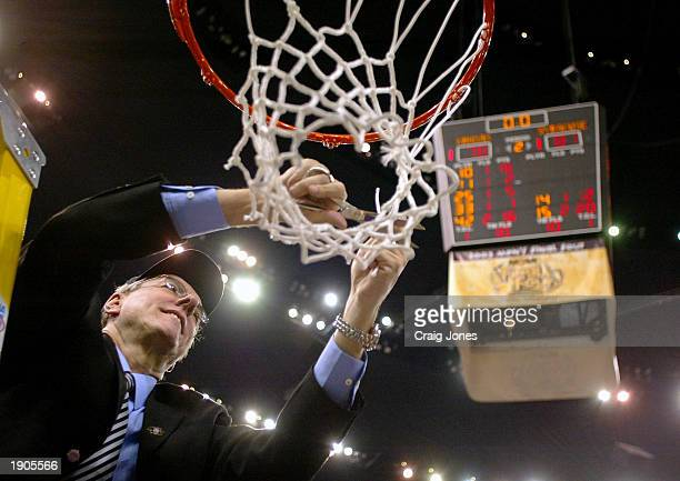 Head coach Jim Boeheim of Syracuse cuts down the net after he and his team defeated Kansas 81-78 during the championship game of the NCAA Men's Final...